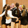 Christian Academy celebrates after scoring a point during their match at Henryville on Tuesday. Staff photo by Christopher Fryer