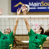 Floyd Central juniors Tierney Flaherty, left, and Sydney Engle attempt to block a Columbus East shot during the first set of the championship match of the Hoosier Hills Conference volleyball tournament at Floyd Central on Saturday. Columbus East won the match in 2 sets, 26-24, 25-22. Staff photo by Christopher Fryer