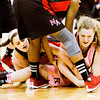 Floyd Central center Brianna Roth fights for possession of a loose ball with New Albany guard Lauren Camm and forward Brianne Nixon during their game at Floyd Central on Saturday. New Albany won the game, 54-46. Staff photo by Christopher Fryer