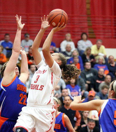 Jeffersonville junior Chelsie Marshall puts up a shot against Silver Creek Friday night at Jeff. Staff photo by C.E. Branham