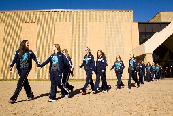 The Providence varsity volleyball team leaves the school following a send-off pep rally in the gymnasium on Friday morning in Clarksville. The Pioneers will face Hammond Bishop Noll in the Class 2A State Championship in Muncie this afternoon. Staff photo by Christopher Fryer