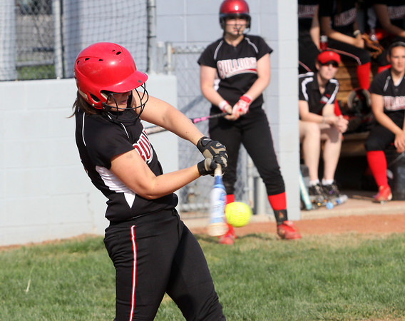 New Albany batter Brittany Jones rips a two-run single against Jeffersonville Monday afternoon. Staff photo by C.E. Branham