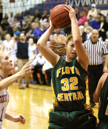 Floyd Central forward Abbie Engle snags a rebound Thursday night against Floyd Central. Staff photo by C.E. Branham