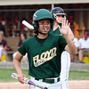 Floyd Central sophomore Katelin Dreher heads to the dugout after scoring in the third inning. Staff photo by C.E. Branham