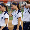 From left, Providence High School players Allie Gillenwater, Stephanie Morris and Adrienne Voelker walk across the infield after their 2A Regional game against Switzerland County High School in Vevay on Tuesday night. Providence lost the game, 6-4. Staff photo by Christopher Fryer