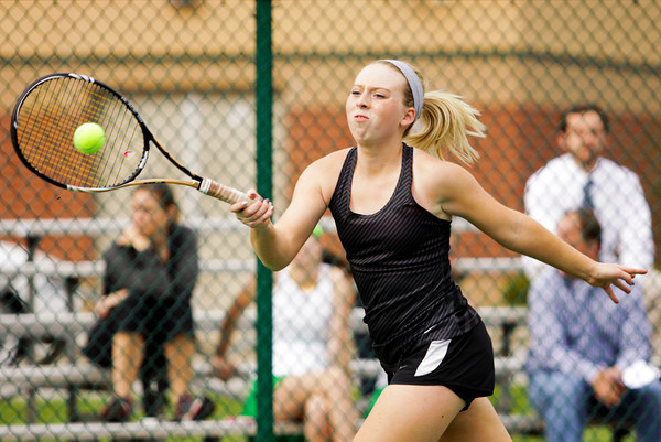 New Albany junior Anne Marie Mattox returns a shot to Floyd Central junior Giorgia Rosetto during their No. 1 singles match at Floyd Central on Monday. Staff photo by Christopher Fryer