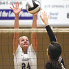 Providence sophomore Haley Libs goes up to block a shot by Henryville Junior Tami Burgin Monday night at the Larkin Center. Staff photo by C.E. Branham