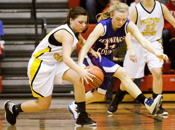 Floyd Central guard Shelby Rost scrambles for a loose ball during their game against Jennings County in the New Albany sectional tournament on Friday. Floyd Central won the game, 52-46. Staff photo by Christopher Fryer
