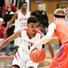 New Albany senior Davon Winburn guards Silver Creek senior Nick Tinsley during the Bulldogs' home game against the Dragons on Friday. Staff photo by Christopher Fryer