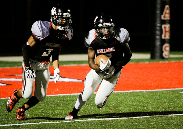 New Albany sophomore Jaylin Ray, right, moves the ball downfield on a kick-off return during the Bulldogs' home game against Castle on Friday. Staff photo by Christopher Fryer