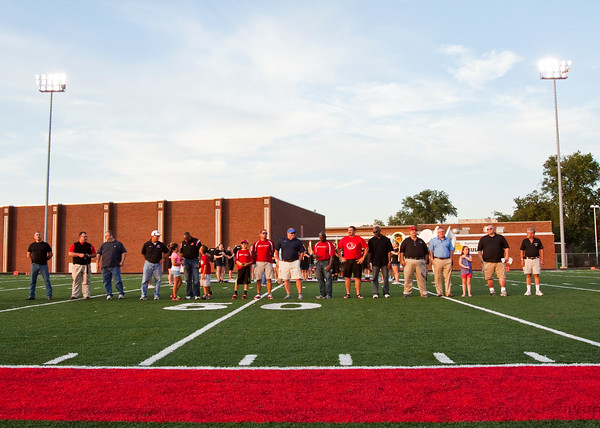 Members of the 1984 sectional championship team are honored before the start of New Albany's home game against Castle on Friday. Staff photo by Christopher Fryer