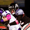 New Albany junior Demetrius Watkins tackles Seymour sophomore Zach Carpenter during the Bulldogs' home game against the Owls on Friday. Staff photo by Christopher Fryer
