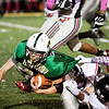 Floyd Central senior Gaige Klingsmith fights for yards on a carry during the Highlanders' home game against New Albany on Friday. Staff photo by Christopher Fryer