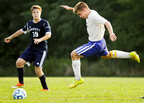 Christian Academy of Indiana junior Cole Ragland cuts through the Providence defense during the Warriors' home match against the Pioneers on Monday. Staff photo by Christopher Fryer