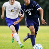 Providence senior Roman Arvizu and Christian Academy of Indiana freshman Declan Hamm fight for possession of the ball during the Warriors' home match against the Pioneers on Monday. Staff photo by Christopher Fryer