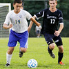 Christian Academy of Indiana freshman Marcello Gelsomini and Providence senior Logan Rauck fight for possession of the ball during the Warriors' home match against the Pioneers on Monday. Staff photo by Christopher Fryer