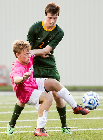 Providence senior Alex Ebert and Floyd Central sophomore Brody Zink fight for possession of the ball during the Pioneers' home game against the Highlanders on Thursday. Staff photo by Christopher Fryer