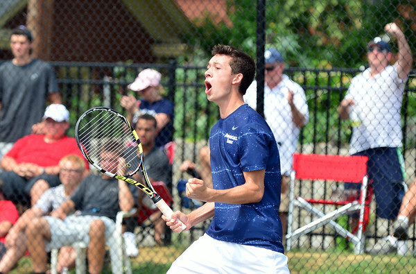 Providence senior Ryan Day celebrates after earning the match point over New Albany in the No. 1 doubles final during the New Albany Invitational Saturday morning. The Pioneer No. 1 doubles team earned their victory in three sets, 6-3, 6-4 and 6-4. <br /> Staff photo by Tyler Stewart