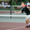 Bulldog sophomore Logan Charbonneau returns a short lob during his match against Scottsburg in the No. 1 singles final at the New Albany Invitational Saturday morning. Charbonneau won in two sets.<br /> Staff photo by Tyler Stewart