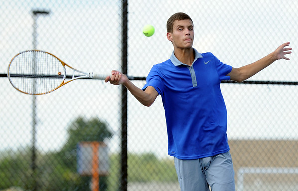 Silver Creek senior Isaac Corum returns the ball during the No. 1 Singles match against Jeffersonville Wednesday at Silver Creek. Corum would lose in two sets to Austin Hunt, 6-0 and 6-3.<br /> Staff photo by Tyler Stewart