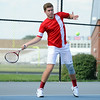 Red Devil senior Austin Hunt serves the ball during the No. 1 Singles match against the Dragon's Isaac Corum at Silver Creek Wednesday. Hunt earned the win in two sets, 6-0 and 6-3. <br /> Staff photo by Tyler Stewart