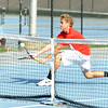 Red Devil junior Sam Coward returns a short lob for the match point in the No. 1 doubles match against the Dragons at Silver Creek Wednesday. Coward, along with junior Jack Reilly, won in two sets, 6-0 and 6-1.<br /> Staff photo by Tyler Stewart
