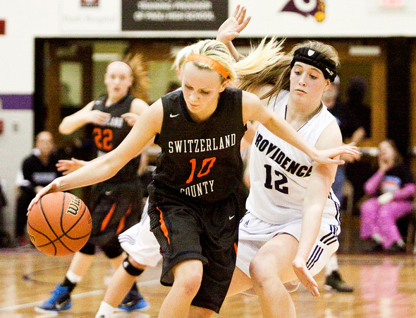 Providence freshman Marissa Hornung guards Switzerland County senior Hailee Lay during the Pioneers' win over the Pacers in the championship round of the Paoli Regional on Tuesday. Staff photo by Christopher Fryer