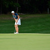 Providence junior Colleen Geldermann sinks a putt from 15 feet out on the 13th hole during the final round of play in the Sunnyside Class at Champions Pointe Golf Course Wednesday. <br /> Staff photo by Tyler Stewart