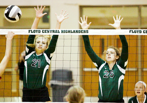 Floyd Central sophomore Maddie Weber, left, and senior Lauren Koopman attempt to block a shot during the Highlanders' home game against DuPont Manual on Thursday. Staff photo by Christopher Fryer