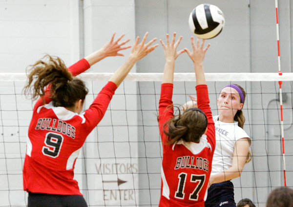 Providence junior Jacquie Hornung goes up for a shot during the Pioneers' home game against New Albany on Tuesday. Providence took the match in three sets. Staff photo by Christopher Fryer