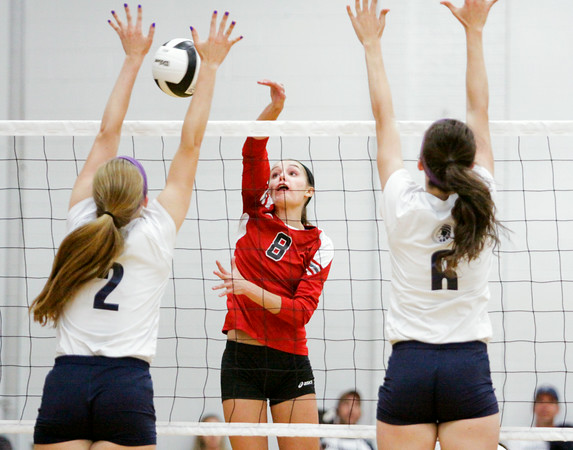 New Albany senior Brook McCoy goes up for a shot during the Bulldogs' game at Providence on Tuesday. Providence took the match in three sets. Staff photo by Christopher Fryer