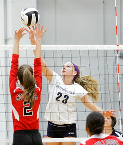 Providence sophomore Lexie Libs goes up for a shot during the Pioneers' home game against New Albany on Tuesday. Providence took the match in three sets. Staff photo by Christopher Fryer
