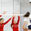 New Albany seniors Alexis Lete, left, and Audrey Donastorg attempt to block a shot during the Bulldogs' game at Providence on Tuesday. Providence took the match in three sets. Staff photo by Christopher Fryer