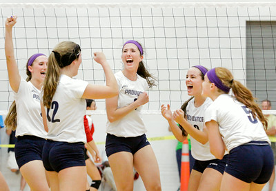 Providence celebrates after scoring a point during the Pioneers' home game against New Albany on Tuesday. Providence took the match in three sets. Staff photo by Christopher Fryer