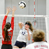 Providence freshman Marissa Hornung goes up for a shot during the Pioneers' home game against New Albany on Tuesday. Providence took the match in three sets. Staff photo by Christopher Fryer