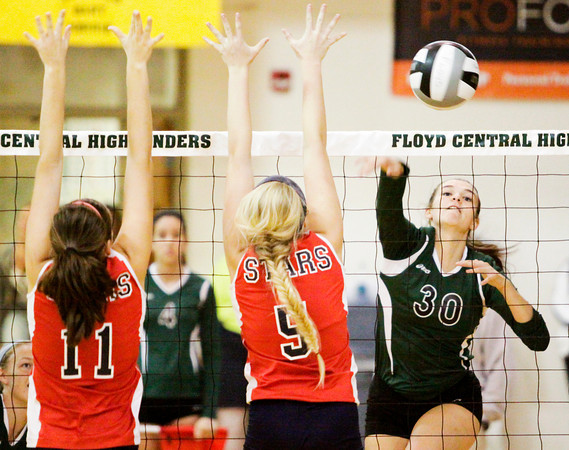 Floyd Central junior Amanda Beckman goes up for a kill during the Highlanders' home match against Bedford North Lawrence on Thursday. Staff photo by Christopher Fryer