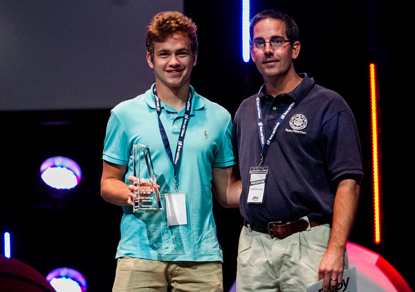 Jeffersonville's Sam Coward, left, accepts the Boys Student-Athlete of the Year Award during the third annual News and Tribune Sports Performance Yearly Awards at Eastside Christian Church in Jeffersonville on Tuesday. Staff photo by Christopher Fryer