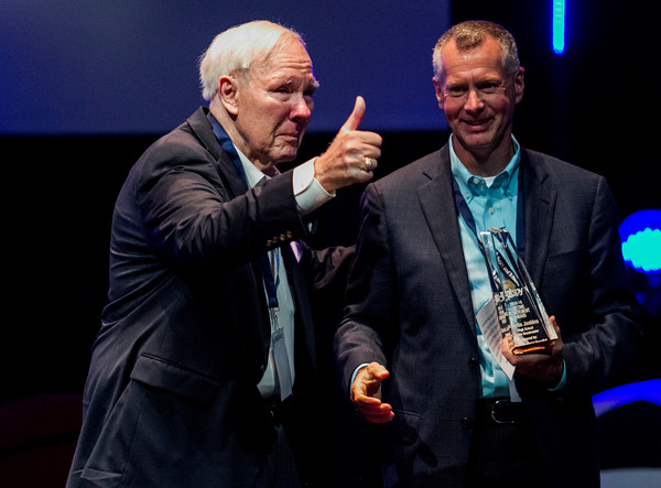 Radio broadcaster Charlie Jenkins, left, accepts the Lifetime Achievement Award during the third annual News and Tribune Sports Performance Yearly Awards at Eastside Christian Church in Jeffersonville on Tuesday. Staff photo by Christopher Fryer