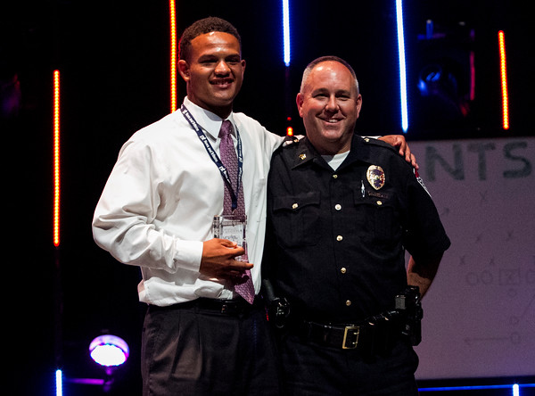 Jeffersonville's Cameron Northern, left, accepts the Football Player of the Year Award during the third annual News and Tribune Sports Performance Yearly Awards at Eastside Christian Church in Jeffersonville on Tuesday. Staff photo by Christopher Fryer