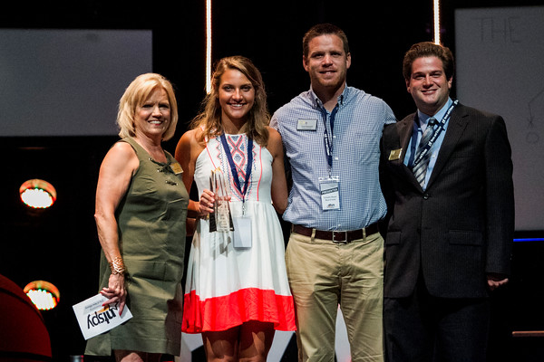 Henryville's Haley Huddleston, center left, accepts the Girls Student-Athlete of the Year Award during the third annual News and Tribune Sports Performance Yearly Awards at Eastside Christian Church in Jeffersonville on Tuesday. Staff photo by Christopher Fryer