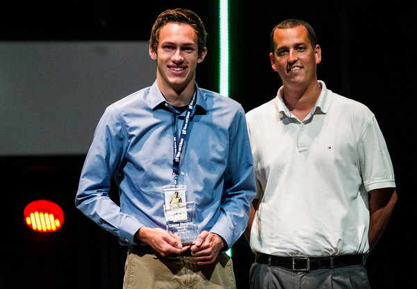 Floyd Central's Conner Sturgeon, left, accepts the Boys Track Athlete of the Year Award during the third annual News and Tribune Sports Performance Yearly Awards at Eastside Christian Church in Jeffersonville on Tuesday. Staff photo by Christopher Fryer
