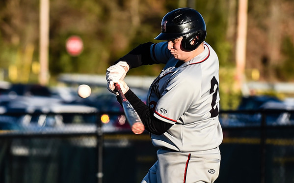 New Albany first baseman Ryan Robison makes contact during the Bulldogs' 4-3 loss to the Floyd Central on Wednesday. Staff photo by Tyler Stewart
