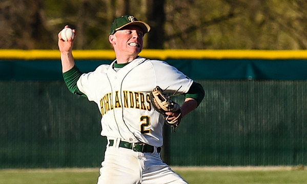 Shortstop Dalton Drexler makes the throw to first base after fielding a New Albany grounder during the Highlanders' 4-3 win over the Bulldogs on Wednesday. Staff photo by Tyler Stewart