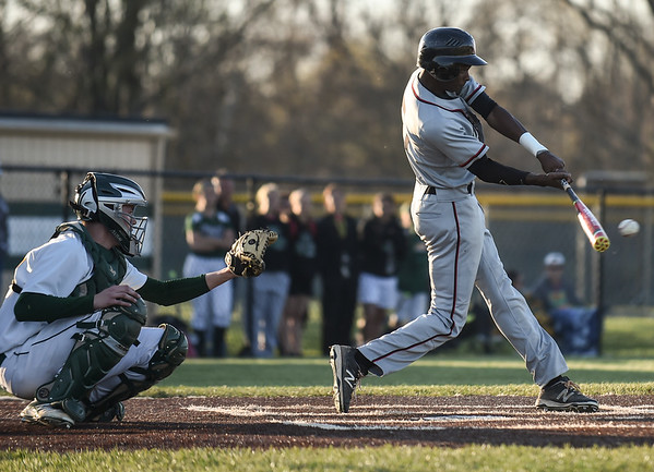 New Albany centerfielder A.J. Nixon connects for a single during the Bulldogs' 4-3 loss to Floyd Central on Wednesday. Staff photo by Tyler Stewart