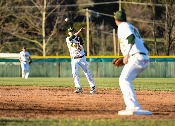 Floyd Central second baseman Brayden Edwards makes the throw to first baseman DJ Bostick during the Highlanders' 4-3 win over New Albany on Wednesday. Staff photo by Tyler Stewart