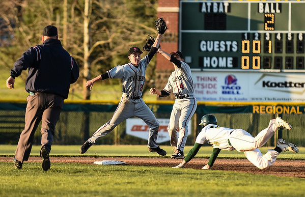 Floyd Central senior Evan Jewell dives to beat the incoming throw to New Albany shortstop Matt Sogge (8) and second baseman Reed Plunkett (4) during the Highlanders' 4-3 win over the Bulldogs on Wednesday. Staff photo by Tyler Stewart