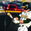 Floyd Central outfielder Max Baumann follows his hit during the Highlanders' 4-3 win over New Albany on Wednesday. Staff photo by Tyler Stewart