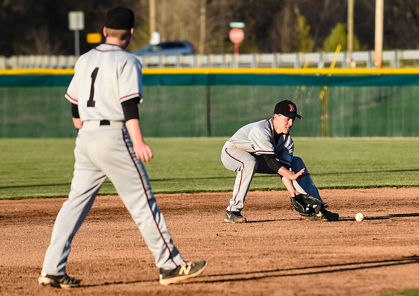 New Albany shortstop Matt Sogge fields a Floyd Central grounder during the Bulldogs' 4-3 loss to the Highlanders on Wednesday. Staff photo by Tyler Stewart