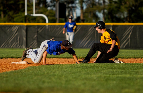Clarksville's Alex Spencer is forced out at second base by Charlestown's Adam Ward during the Generals' 9-4 home loss to the Pirates on Thursday. Staff photo by Christopher Fryer