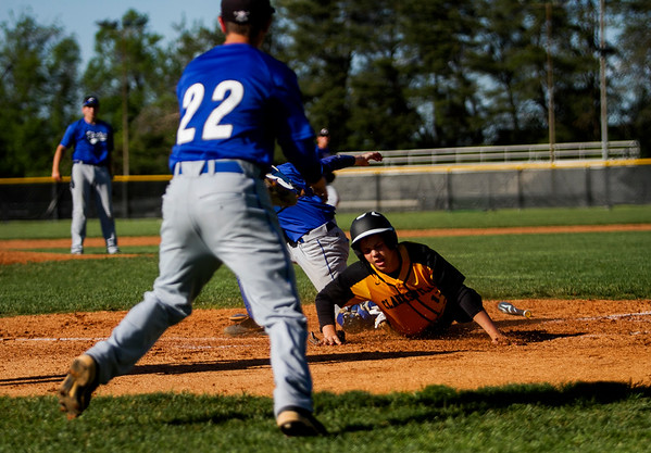 Clarksville's Blayden McMahel slides safely into home plate during the Generals' 9-4 loss to Charlestown at home Thursday. Staff photo by Christopher Fryer